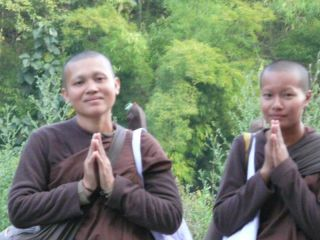 On the lonely stretch of country road, I came upon these 2 women monks walking. This was how they greeted me.