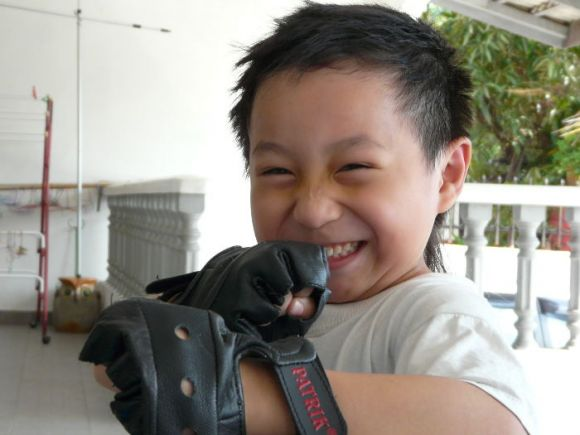 This cute little fella is Jarvis Leow. He is ready to play !!