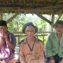 "These men said they\'ve finished work in their plantations - now they need to roll up a ""rokok\"" before going home."