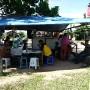 Everyone is relax now. Tea break by a roadside stall