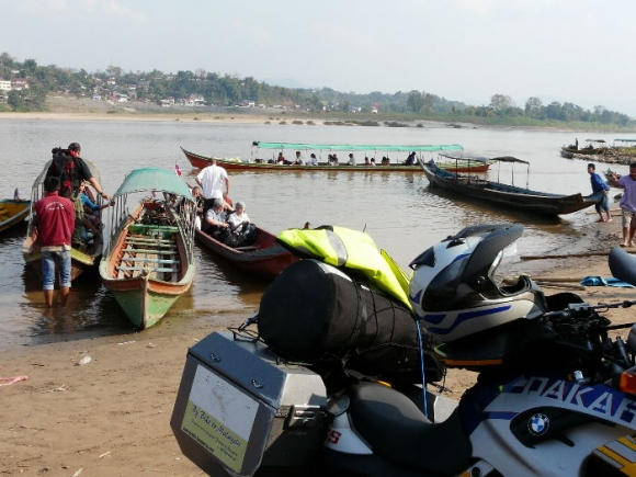 Just wondering how I'm going to get my bike across the Mekong River on one of these narrow longboats to the Laos border town of Huay Xai on the other side.