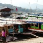 Mekong River slowboats that take tourists down on a 2 days trip to Luang Prabang.