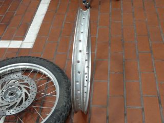 """This photo confirm that the original rim was really off true circle. Replaced by a temp 2nd hand Japanese 21"""" rim (equally not true circle, but rideable)."""