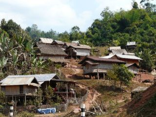 Typical village out in the countryside in Northern Laos. Many villages out here in the hills have no electricity or pipe-in water.