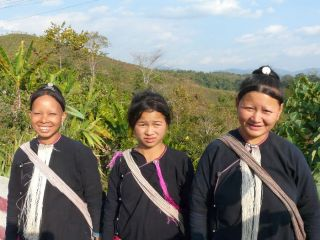 We couldn't understand each other but these ladies (from which hill tribe ??) graciously smile for the camera.
