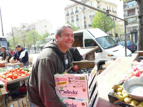 Happy fruit seller at Castellane street market, Marseille