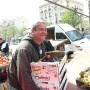 Happy fruit seller at Castellane street market, Marseille